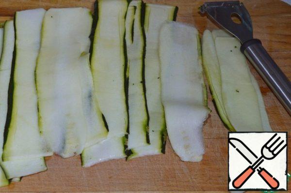 Zucchini cut into thin strips in a convenient way.