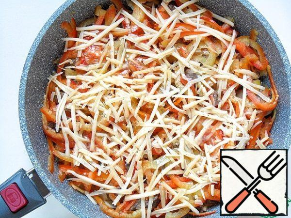 Pour this mixture evenly over the contents of the pan and sprinkle with grated cheese on top,