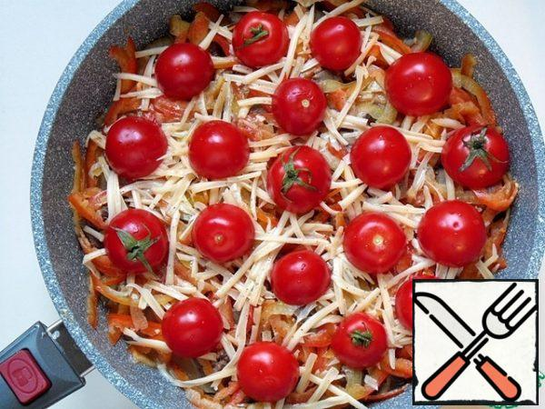 spread out the tomato slices ( I have small, cut into halves), cover with a lid, bake on low heat for 10 minutes,