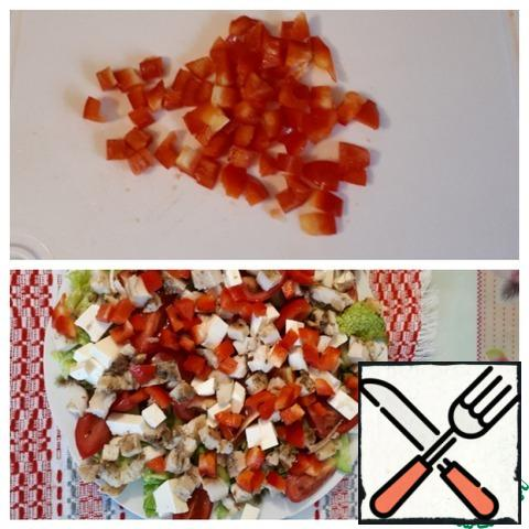 Add the chicken and diced bell pepper to the vegetables.
