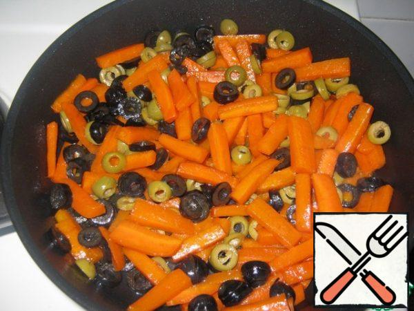 Add olives to carrots and heat for 1-2 minutes, remove from heat.