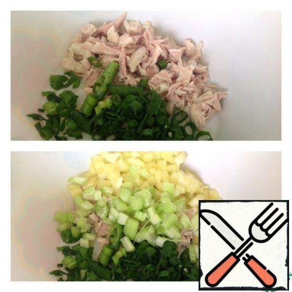 Cut the boiled chicken breast into small cubes and chop the onion. Add bell pepper and celery finely diced.