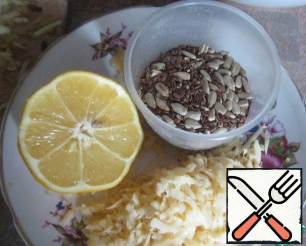Three cheese, mix the seeds, squeeze the lemon into the oil, add garlic and seeds.