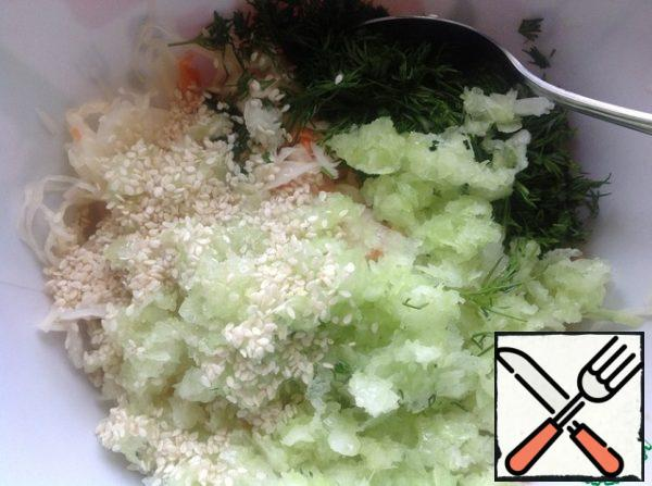 Add oil and sesame seeds.  Stir the salad thoroughly.