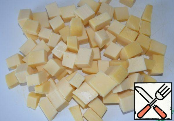 Cut the cheese into small cubes.
