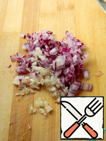 Finely chop the onion and garlic, add to the tomatoes.