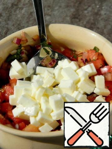 Cut cheese into cubes and combine with vegetables.