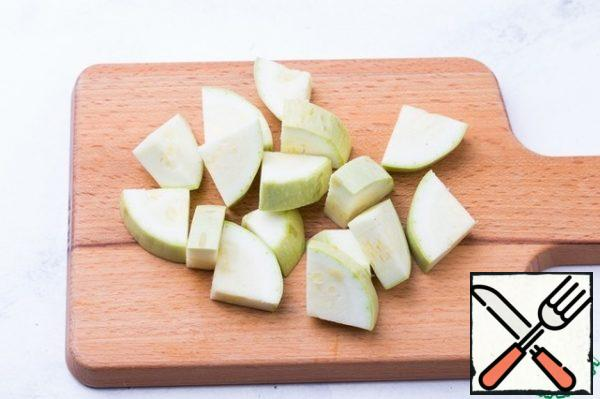 Cut the zucchini into small segments.