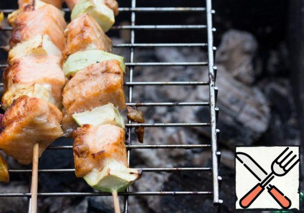 Cook kebabs on low-heat coals on a grill for 3-4 minutes on each side, periodically greasing with a mixture of oil and soy sauce.