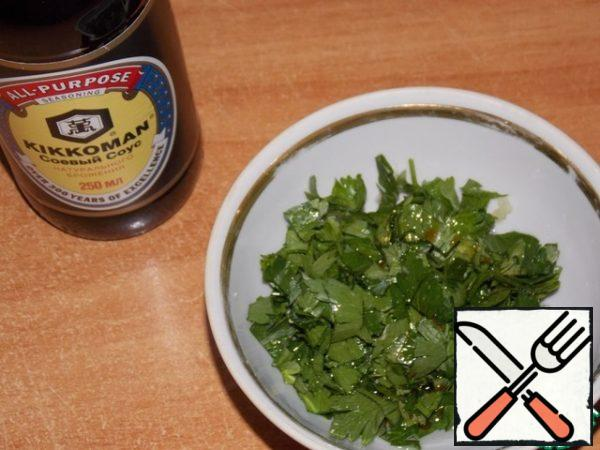 Add the parsley and soy sauce to the garlic and stir.