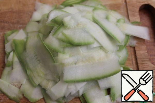 Cut the zucchini as thin as possible (a vegetable peeler is good for this). Salt and leave for half an hour.