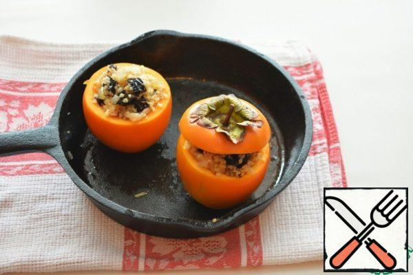 Fill the persimmon with the filling, cover with the cut ones, and place in a heated oven. Bake at 200 degrees for 20-25 minutes.