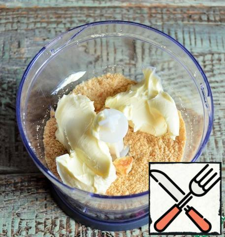 Chop the cookies in a blender, add soft butter, and punch in a blender.