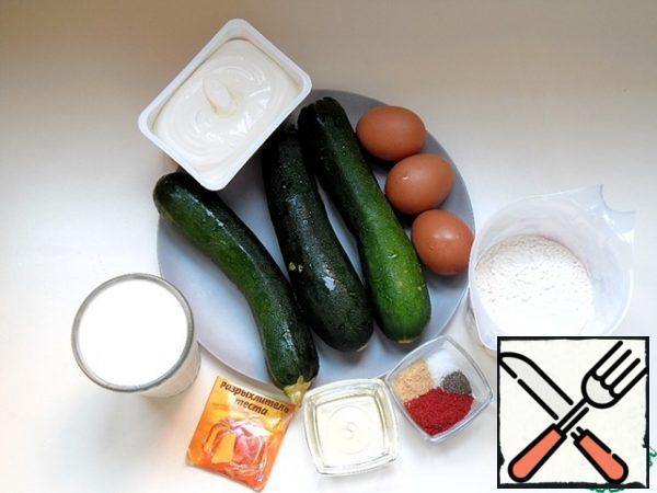 We will prepare the necessary products. Wash the zucchini, clean the stalk, if there is damage on the surface - remove, do not remove the skin. Prepare all the spices, curd cheese should be at room temperature, sift the flour.