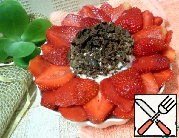 Strawberries spread on chocolate ice cream.
