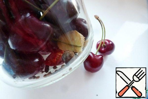 Put the spices in a jar (or other suitable container), then fill it with cherries.