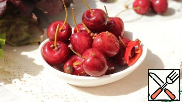 Serve pickled cherries as an appetizer with cheese and wine. This cherry looks spectacular as a decoration for baked meat or poultry.