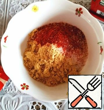 Mix all the dry ingredients: mustard powder, salt, cane sugar, ground sweet paprika and ground hot pepper.