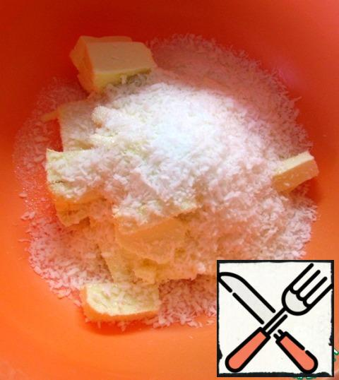 Dough: in a bowl, combine the pieces of cold butter, sugar and coconut flakes. Add a pinch of salt and flour.