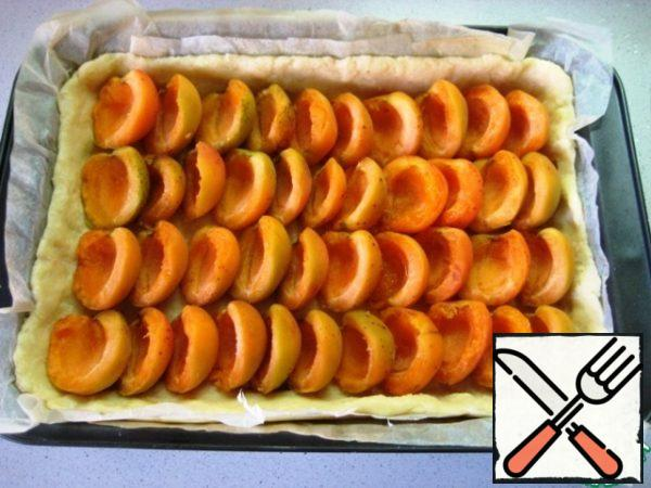 Put the apricot halves on top.