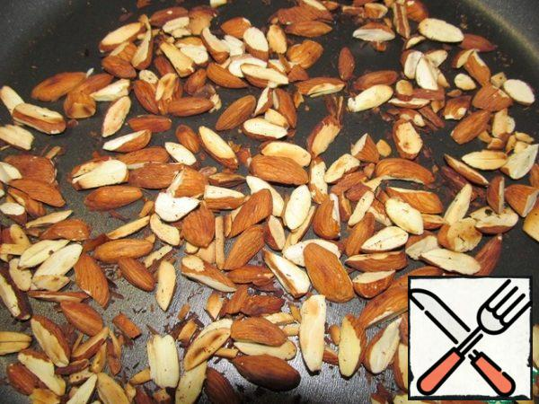 Fry the almond plates in a dry pan.