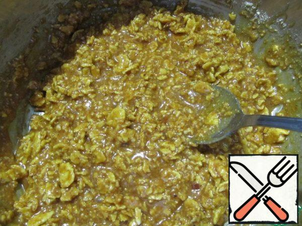 Add the cream and butter and bring to a boil (stirring constantly). Remove from the heat, allow to cool slightly, then stir in the almond and cornflake mixture. Stir quickly and thoroughly.