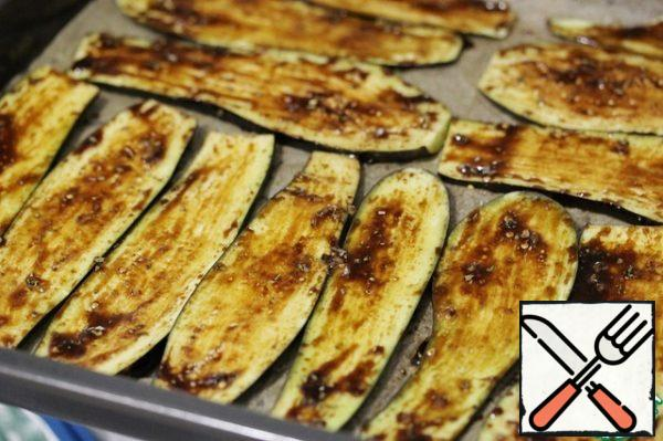 Use a brush to apply the marinade to the eggplant slices.