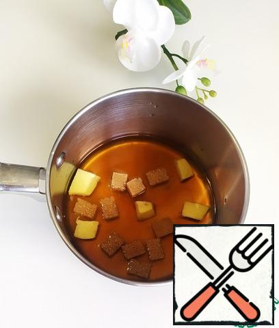 In a saucepan, combine the chopped ginger and sugar and pour in 250 ml. waters. Bring to boil.