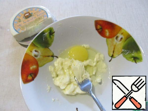 RUB the egg with 50 g of softened butter.