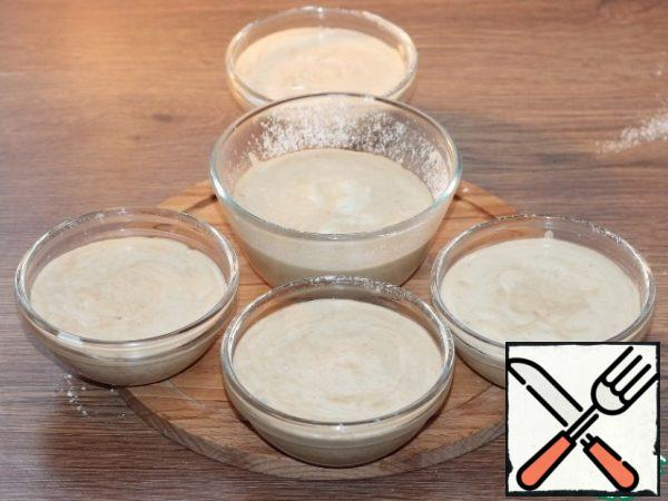 Put the souffle in the molds and place in a deep baking tray. Pour hot water ~ 2 cm high into a baking tray and place in a preheated 180 C oven.