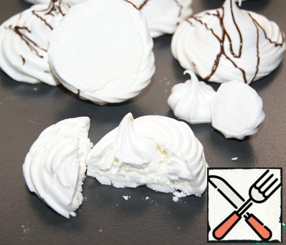 I deliberately broke and turned the meringue so that you can see that the bottom of the meringue is as white as the top.