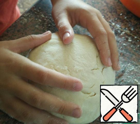 Form a small bun from the dough.