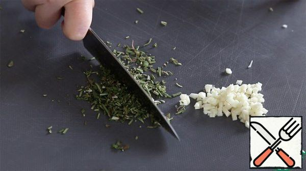 Finely chop the garlic and herbs-rosemary and thyme.