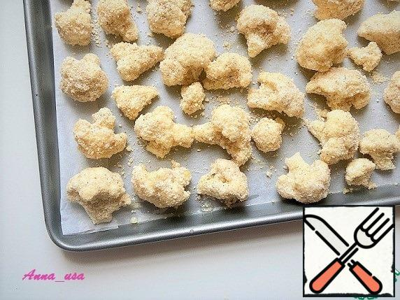 Preheat the oven to 204*C (400*F) and cover the baking sheet with parchment. Dip each piece of cabbage in oil and roll in a mixture of breadcrumbs and Parmesan. Place on a baking sheet and bake for 20-25 minutes until Golden brown.