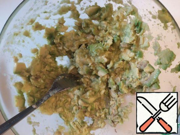 Slice and mash the avocado.