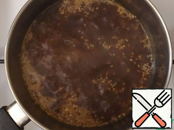 Pour the marinade into a ladle and bring to a boil.