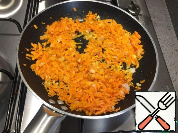 Fry the onion, garlic, and carrot in olive oil until Golden brown.