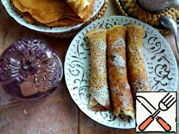 To serve, I rolled the pancakes into tubes and sprinkled them with powdered sugar and cinnamon. Pancakes can be served with whatever you want!