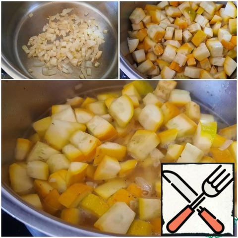 Onions and garlic finely chopped. Heat the olive oil and simmer lightly. Cut the zucchini into cubes, add to the pan, and simmer for 5 minutes. Add vegetable broth or water and simmer for 10-15 minutes until tender.