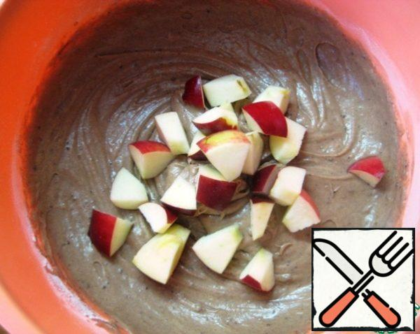 Add sliced apples. Mix them into the dough.