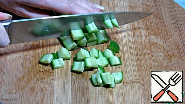 Also, cut the cucumber into small cubes.