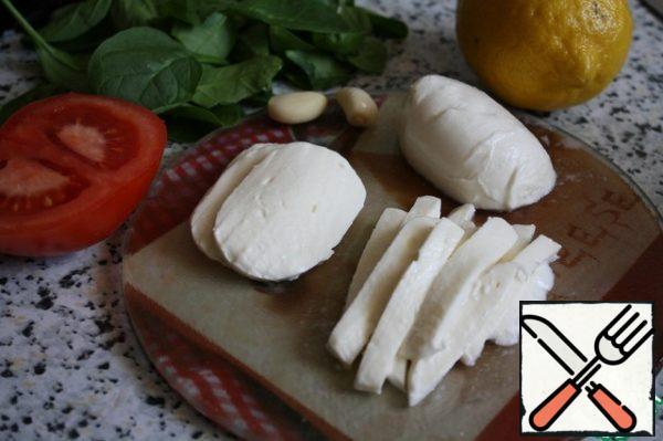 Cut the mozzarella into thin slices or strips.
