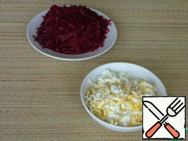 Eggs and beets are cooked until ready, cooled and grated on a large grater.