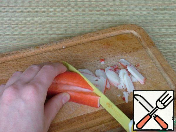 Crab sticks are cut into large slices.