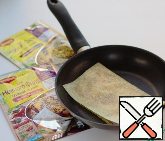 Put the chicken breast on a frying sheet, cover with the other half of the sheet, press with your palm and fry in a preheated frying pan without oil on both sides for 5-7 minutes over low heat.