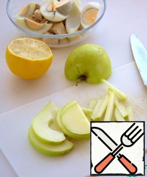 Apple, preferably not sweet, cut into strips and sprinkle with lemon juice.