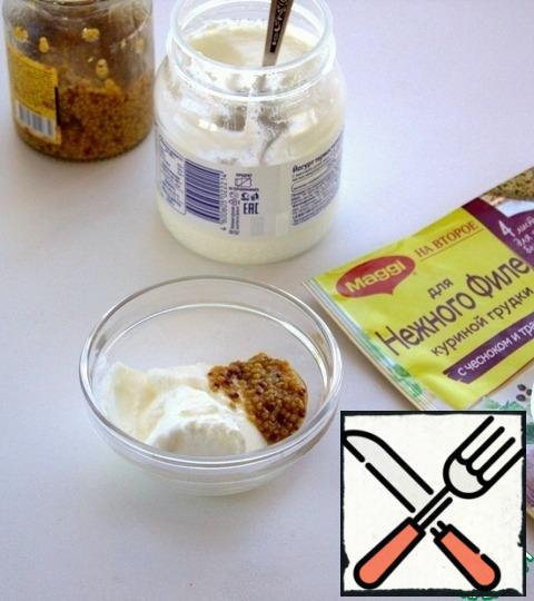 Prepare the dressing.  Mix yoghurt with granular mustard in a cup.