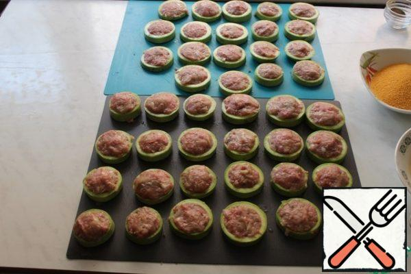 Each ring of zucchini stuffed with minced meat.