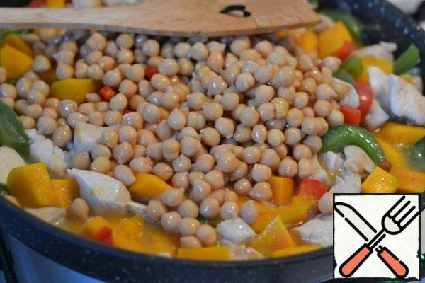 I have canned chickpeas. Drain the liquid and add to the stew. Stir and simmer for another 5 minutes.