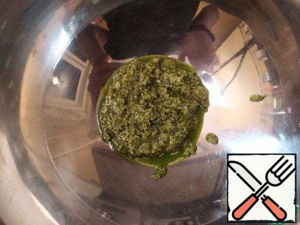 Transfer the pesto to a larger bowl.